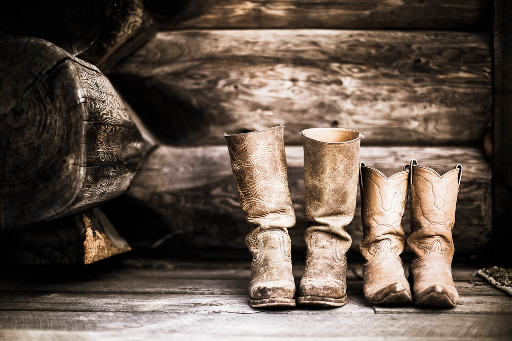 Cowboy boots in a log cabin